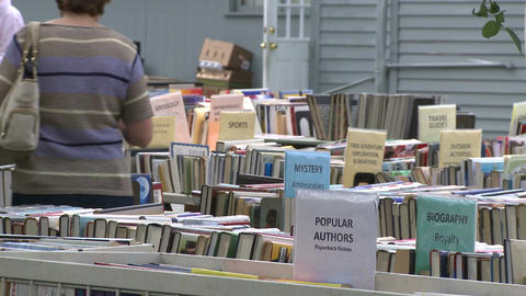 Books being displayed at an outdoor book fair (2 of 4) Live Action