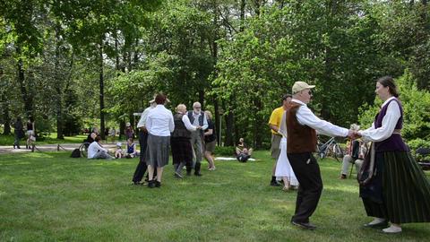 people dancing folk dances in pairs in park folk event Footage