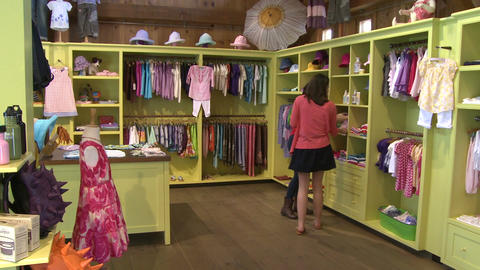 Women looking at different items at a Children's Boutique (1 of 4) Live Action