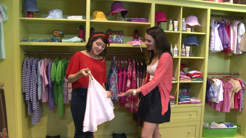 Women looking at different items at a Children's Boutique (3 of 4) Live Action