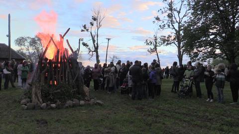 People warm near big fireplace celebrate national John holiday Footage