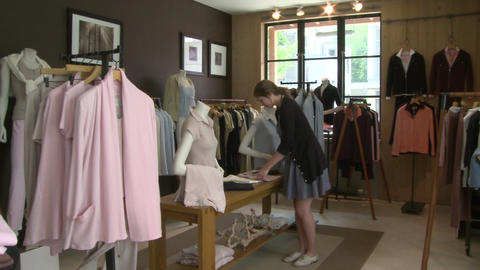 Woman looking in a designer clothing store (1 of 4) Live Action