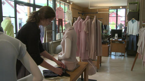 Woman looking in a designer clothing store (3 of 4) Live Action