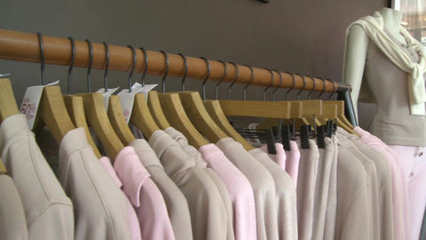 Clothes being display in a designer clothing store (1 of 2) Live Action