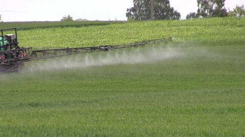 tractor spray fertilizer cereal field for growth. agronomy work Footage