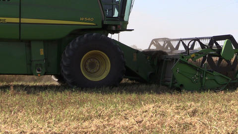 village agriculture machine combine harvester cut cereal Footage