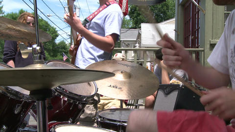 Guitar player and a drummer playing in a band (1 of 3) Live Action