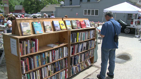 Books being displayed at an outdoor book fair (4 of 4) Live Action