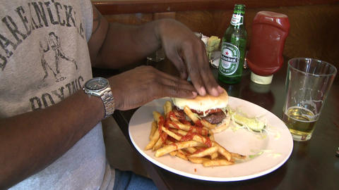 Man eating hamburger with french fries (2 of 2) Footage