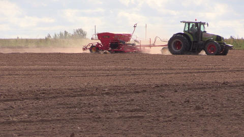 Tractor with special equipment fertilize sow field in autumn Footage