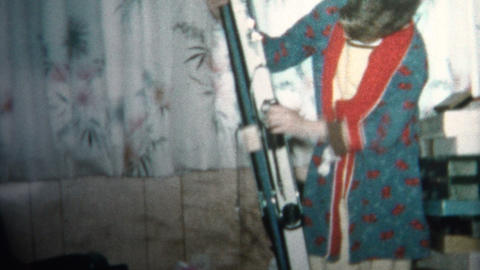 (8mm Vintage) 1965 Boy Gets Skis for Christmas Gift Footage
