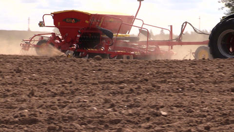 Special equipment spread fertilizer on cultivated field soil Footage