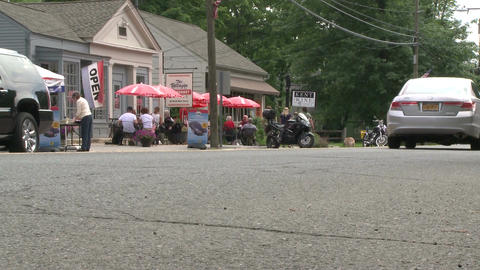 Small sidewalk cafe along the road Footage
