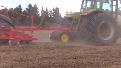 Tractor with special equipment fertilize sow field in summer Footage
