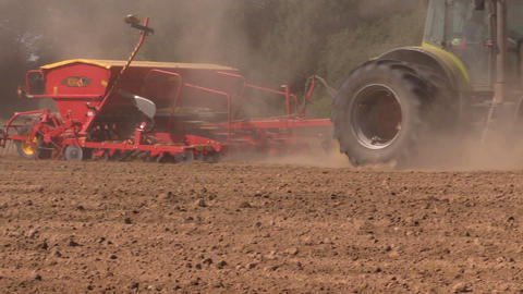 farm tractor harrow and fertilize country field Footage