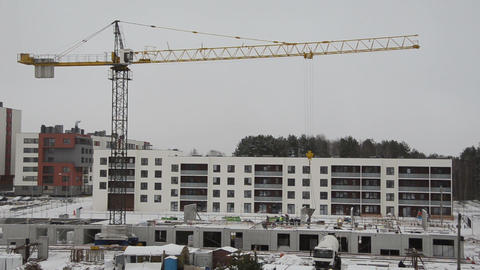construction cranes bag of concrete for new home building Footage