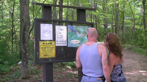 A couple looking at a trail map for Bulls Bridge Recreational Facility (1 of 2) Footage