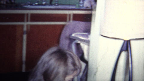 (8mm Vintage) 1965 Kid Gets Toy Bazooka Weapon For Christmas Footage