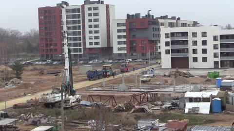 Asphalt pavement works near new build modern flat houses Footage