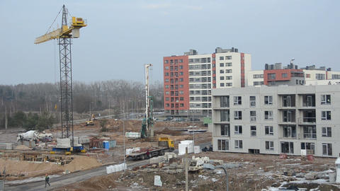 Industrial construction site with workers and crane Footage
