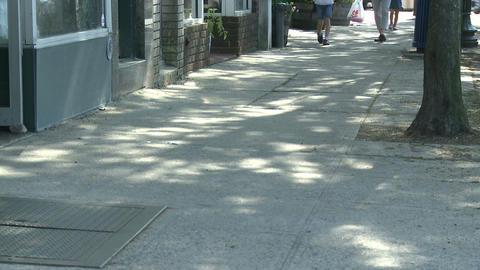 Shoppers walking down sidewalk Footage