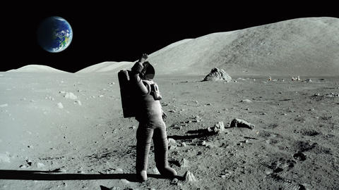 Astronaut waving to the camera on the moon, earth in the background Footage