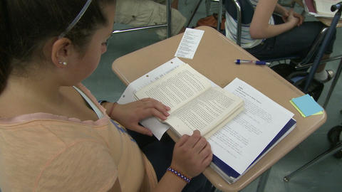 Middle school girl reading in class Footage