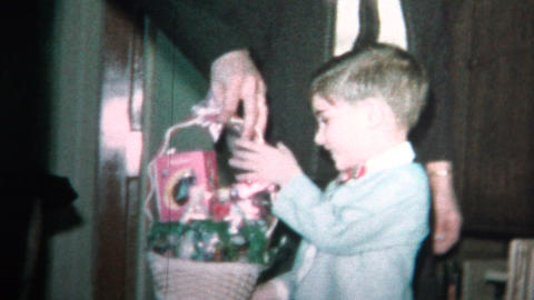 (8mm Vintage) 1965 Child With Easter Basket From Mom and Dad Footage