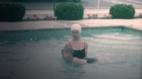 (8mm Vintage) 1966 Mom Teaching Son How to Swim Hotel Pool Footage