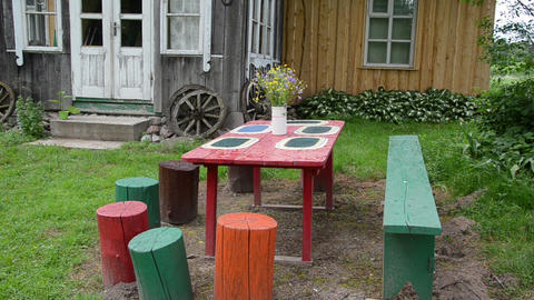colors painted stumps around wooden table Footage