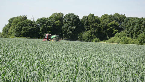 tractor spray nozzles along forest spraying pesticides field Footage