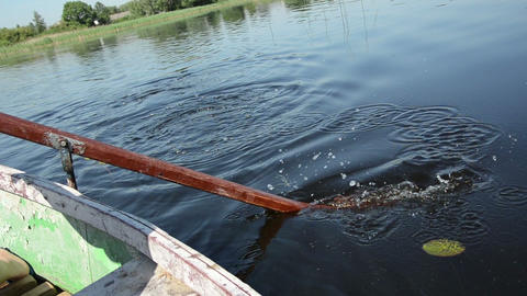 old wooden paddle bounces into the dark blue water Footage