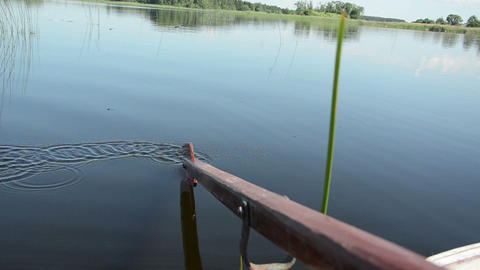 smooth lake surface disturb the touch paddle making circles Footage