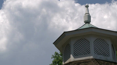 A cupola with clouds passing behind it Footage