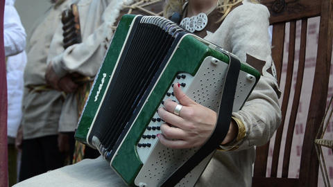 woman hand deftly clicking on accordion black white buttons Live Action