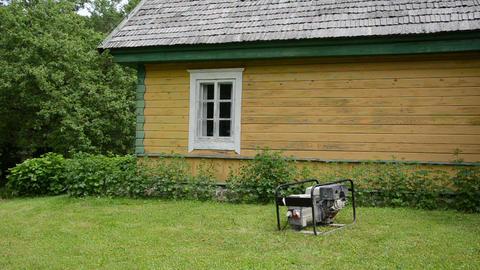 diesel electricity generator work near rural house in village Live Action