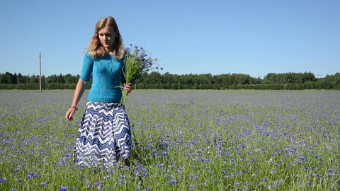 girl blue clothing gather cornflower enjoy beauty of flowers Footage