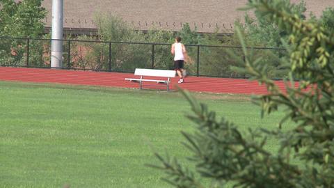 Athlete runs track Footage