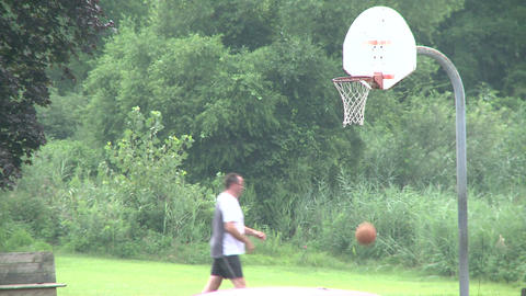 Shooting basketball at a park. (2 of 2) Footage