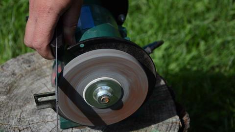 fast rotating black sharpener wheel hand sharpening large blade Footage