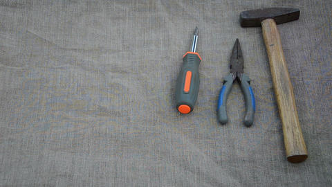 Man hand put hammer pliers screwdriver measure knife tools Footage
