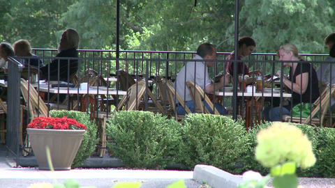Tables overlooking woods at a small out side restaurant Footage
