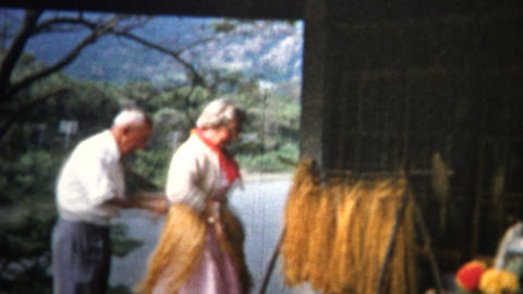(8mm Vintage) 1955 Woman Tries On Hawaiian Hula Dancer Outfit stock footage