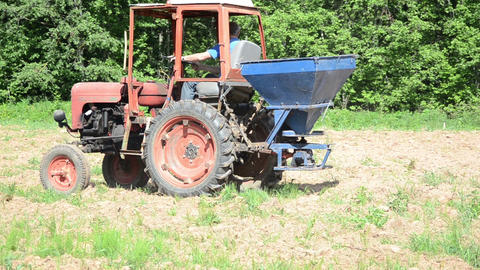 Turn view of agriculture heavy machine sowing seeds in field Footage