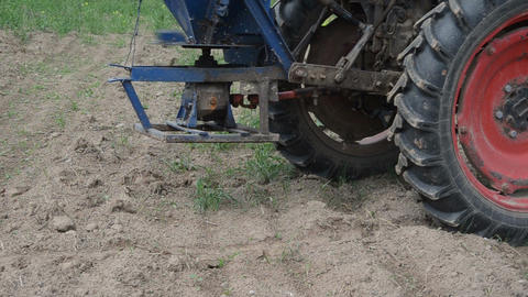 follow tractor wheel seeder equipment sow buckwheat seeds Footage