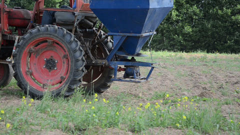 follow retro tractor wheel seeder equipment sow buckwheat seeds Footage