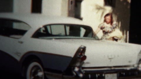 (8mm Vintage) 1956 Children Excited Taking New Car To Church stock footage