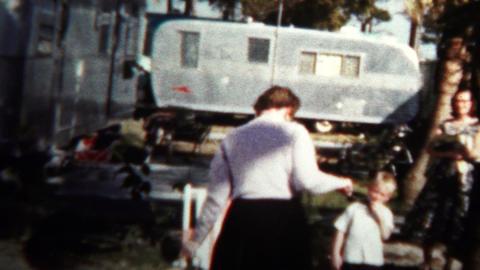 (8mm Vintage) 1957 Women Man Leaving Trailer Home Park stock footage