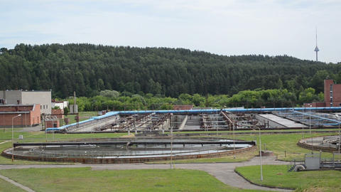 city sewage water treatment plant reservoir pools and equipment Footage