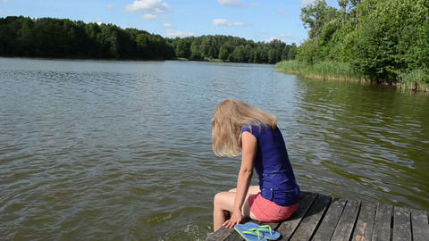 Girl Sitting On Bridge Large Lake Slosh Water Feet Sunny Day stock footage